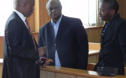 Mario Masuku (middle) and Maxwell Dlamini (right) in court. Internet Photo.